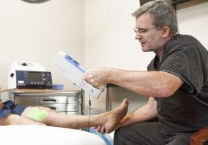 Dr. J. Furlong using the veinviewer flex light on a patient