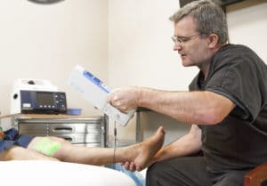 Dr. Furlong performing a FastTrack examination on a patient with a Veinviewer Flex Light.