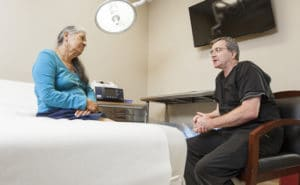 Dr Furlong speaking with a patient about vein care options at a vein clinic